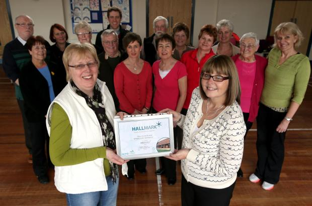 HALLMARK AWARD: Centre chairwoman Maureen Aspey (left) receives the award from Durham Community Action's Barbara Hind
