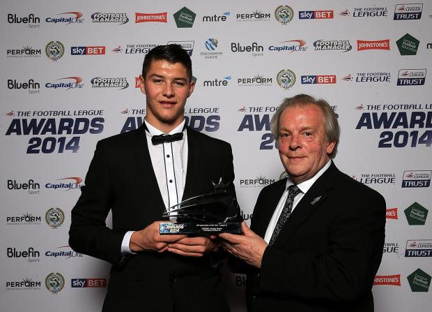 AWARDS DO: Bradley Walker receives his award for apprentice of the year from PFA chief Gordon Taylor at the Football League Awards in London on Sunday evening