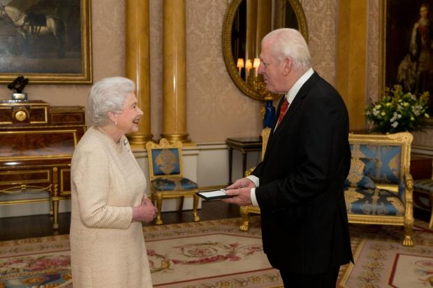 Queen Elizabeth II presents Sir Thomas Allen with The Queen's Medal for Music at Buckingham Palace