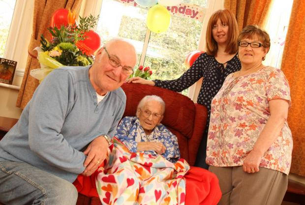 BIG DAY: Maud Brown celebrates her 105th birthday with, from left, son-in-law Michael Wigley, granddaughter-in-law Joanne Wigley and daughter Wendy Wigley