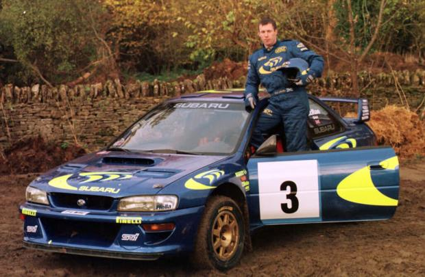 I'M F*****G COLIN MCRAE: The real Colin McRae pictured above during his time in the World Rally Championship with Subaru