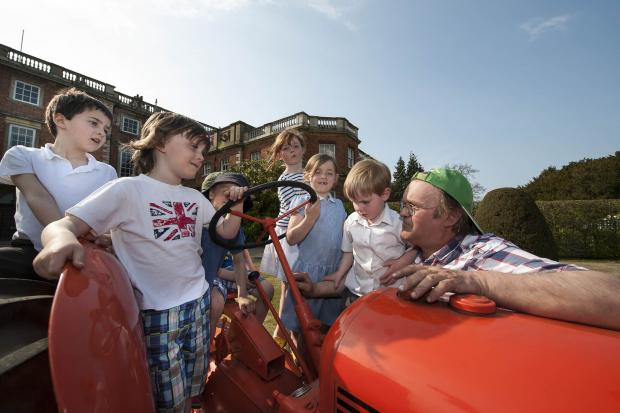 Gearing up for this year's Tractor Fest – local schoolchildren outside Newby Hall with Brian Chester, working steward with the Yorkshire Vintage Assocation.
