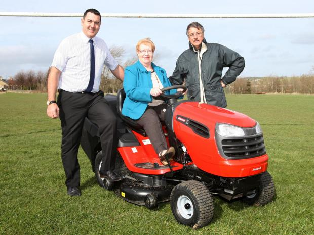 Councillor Rob Yorke, Councillor Christine Wilson and Stan Thexton, from Witton Park FC, with the new lawn mower
