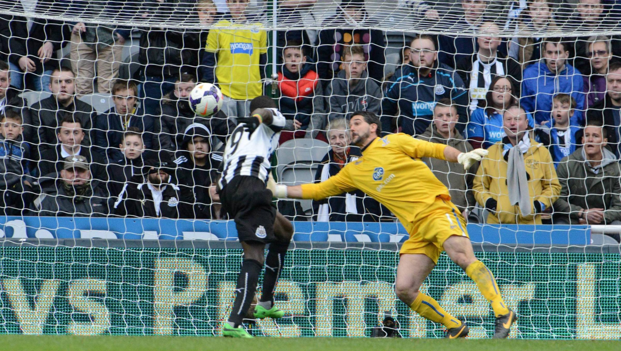 DECISIVE STRIKE: Papiss Cisse leaps to head Newcastle's late winner against Crystal Palace