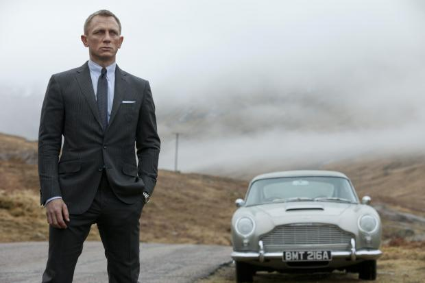 The Northern Echo: Aston Martin's reputation has been helped by its association with James Bond. Actor Daniel Craig is pictured standing in front of the iconic Aston Martin DB5