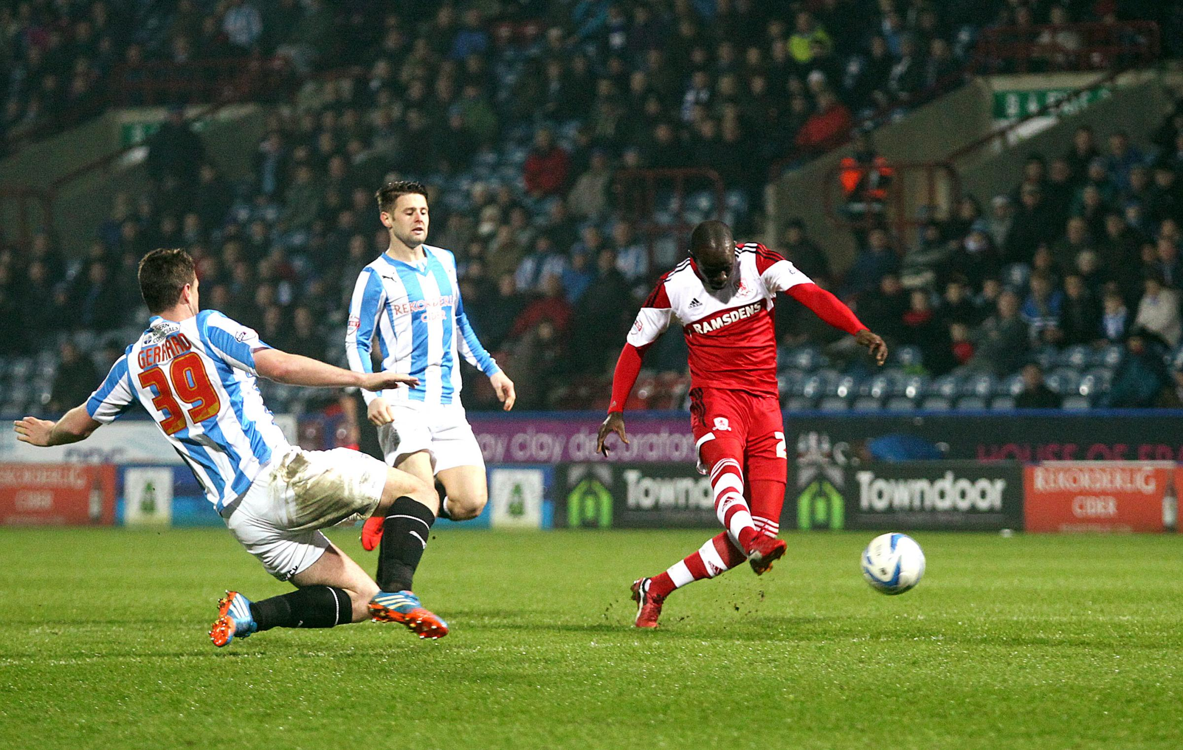 LEVEL AGAIN: Albert Adomah scores his second goal of the evening to equalise at the John Smith's Stadium last night while his teammates join him for the celebrations