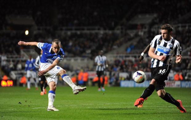 GAME OVER: Everton's Leon Osman hammers the final in Newcastle's coffi