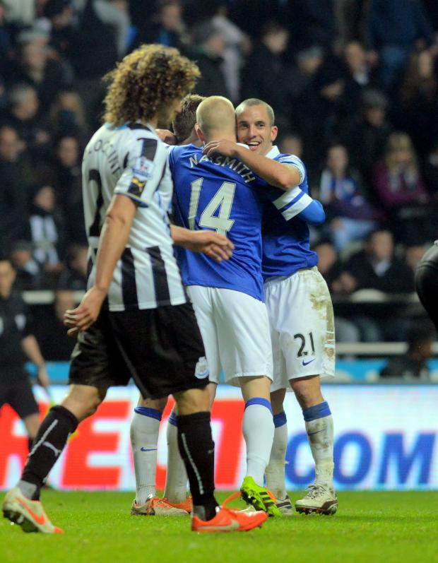 The Northern Echo: DEFLATED: Newcastle United captain Fabricio Coloccini back to his position as Leon Osman celebrates making it 3-0 to Everton last night at St James' Park