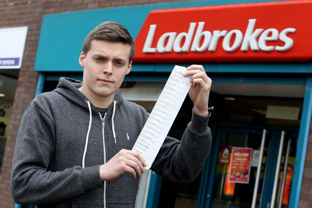 Jordan Donnellan outside Ladbrokes in Consett with his betting receipt.