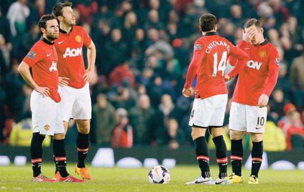 DISASTER SCENARIO: Manchester United's players appear dejected after conceding their third goal last night