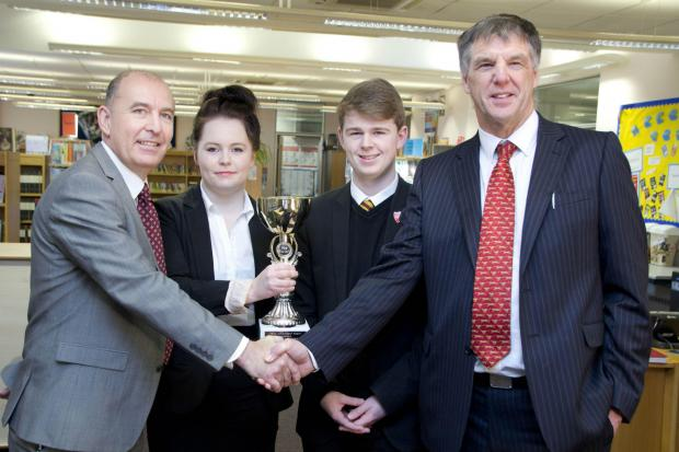 John Rhodes, vice principal at The King's Academy (right) and students Abby Sullivan and Ben Rowden accept the Achievement Award from Tim Gristwood of PHSE For Life