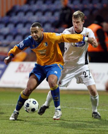 LOAN MOVE: Scott Harrison, right, pictured playing in 2011- 12 for Darlington where he came through the youth ranks, has joined Hartlepool United on loan from Sunderland