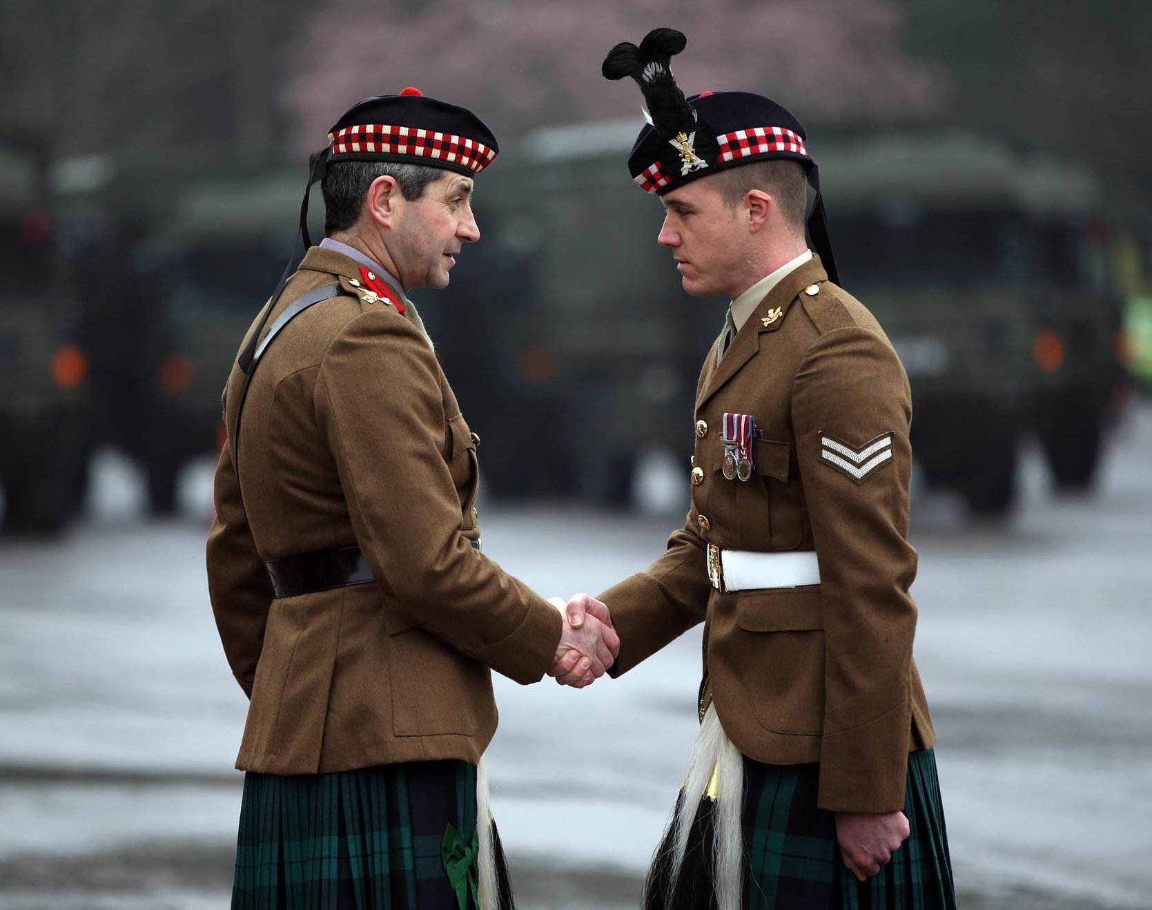 Brigadier Bob Bruce congratulates Corporal Connor Grant, right, of 2 SCOTS on being awarded a Queen's Commendation for Bravery while serving in Afghanistan.