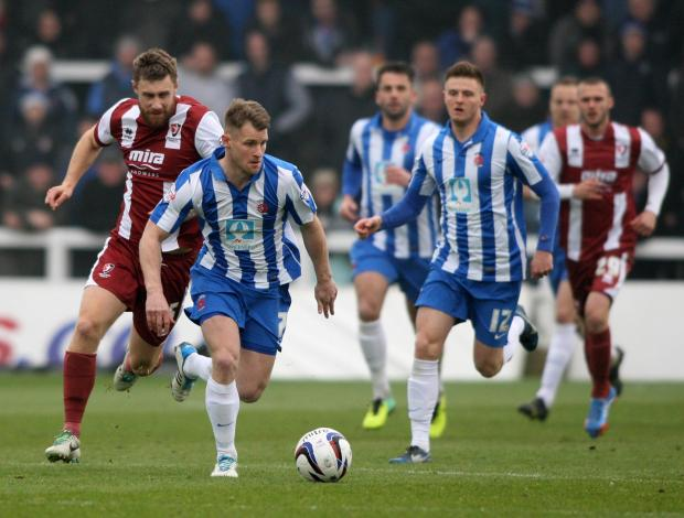 RUNNING MEN: Pools' striker Jon Franks leads the charge
