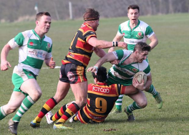 HAVE A GO JOE: Billingham's Joe Evans is brought down in the 45-43 home defeat by Bradford and Bingley