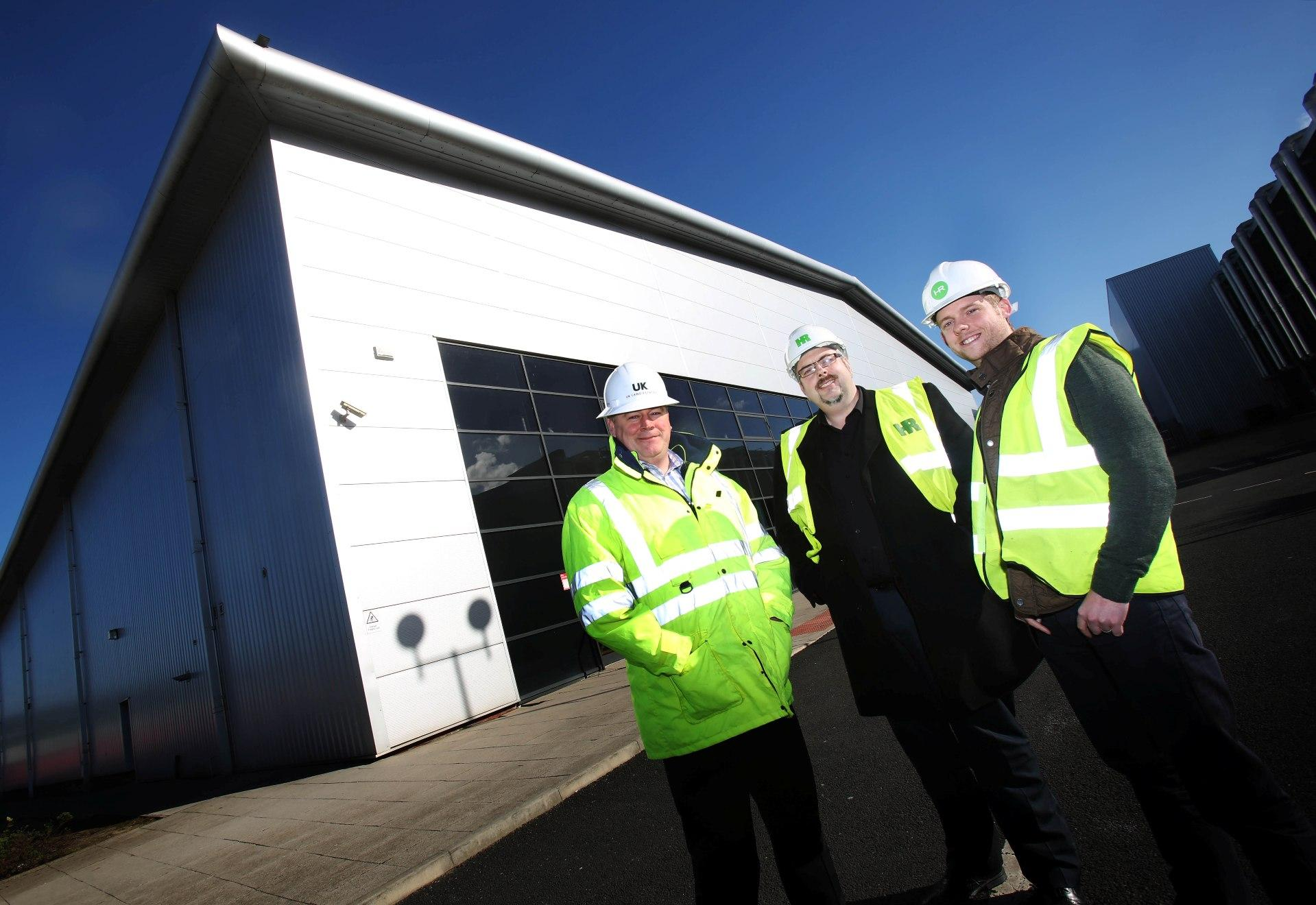 Pictured from left to right are Adrian Bartle, of UK Land Estates, with Barry Wilkinson and Craig Muldoon, from Howard Russell, outside the former