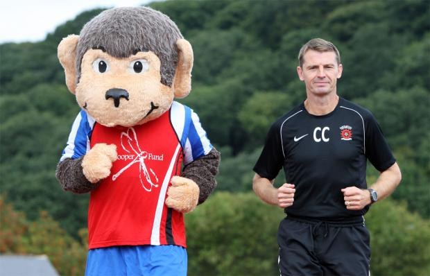 MONKEY BUSINESS: Colin Cooper was joined in taking part in last year's Great North Run with Hartlepool United mascot H'Angus the Monkey