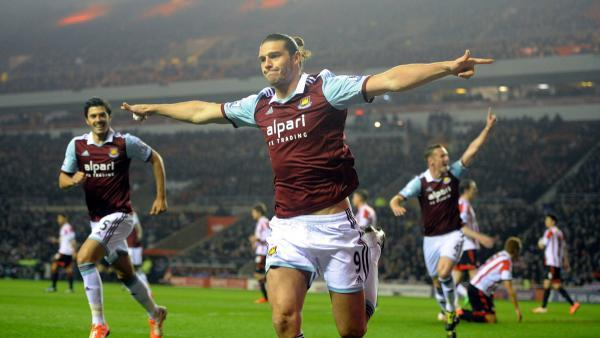 CRUCIAL STRIKE: Andy Carroll celebrates after opening the scoring in West Ham's 2-1 win over Sunderland
