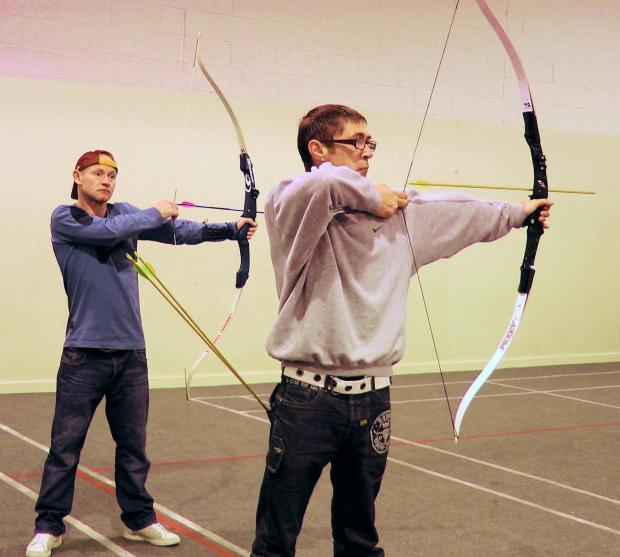 VALUABLE SERVICE: Users of the Moses Project, based in Stockton, try their hands at archery