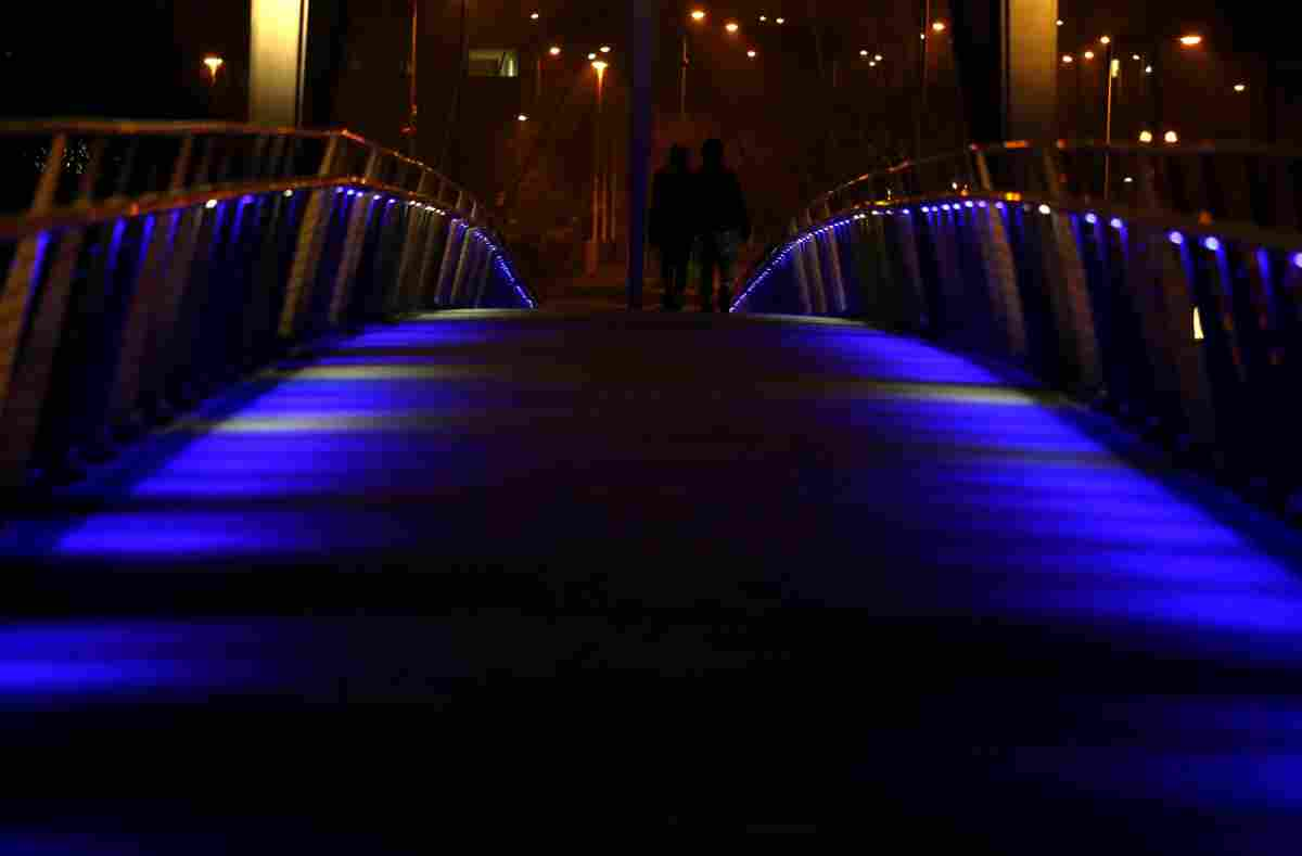 Millenium Bridge, Stockton  -  The walkway is lit in support of the Light It Up Blue campaign.