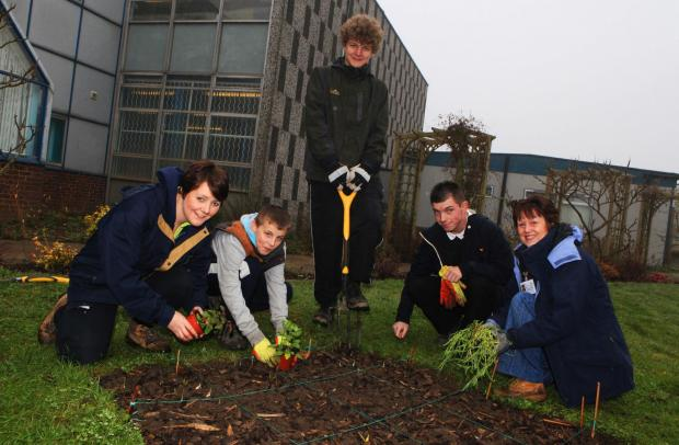GREEN FINGERS: Pupils Shai O'Brien, 14, Tommy-Lee Tallon, 15, and Brett Miller, 15, with Nicola Dexter and Karen Collin from The Cornforth Partnership