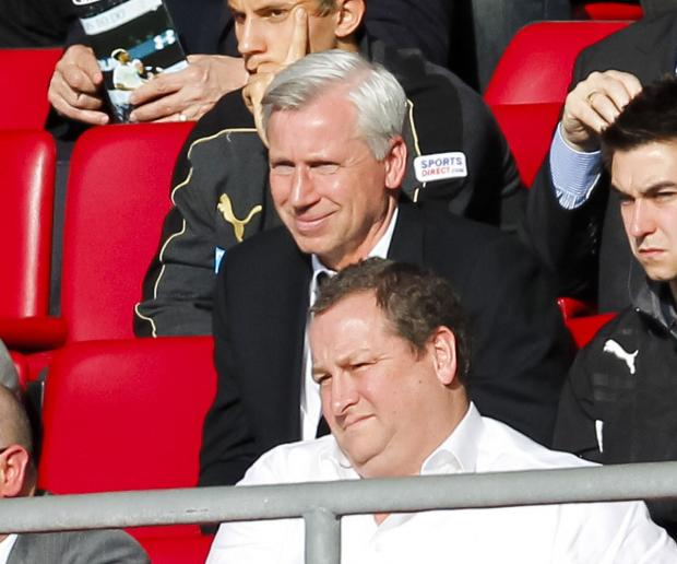 The Northern Echo: Mike Ashley, front, watches Newcastle United's match at Southampton with Magpies' manager Alan Pardew
