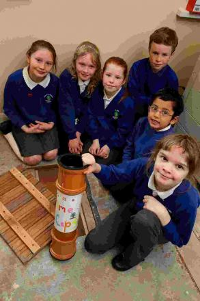 Student council members Erin Clarke (9), Abi McCourt (8), Darcy Crook (7), Leuan Auyeung (6), Ruth Peers (11) and Charlie Phillips (10) with the time capsule.