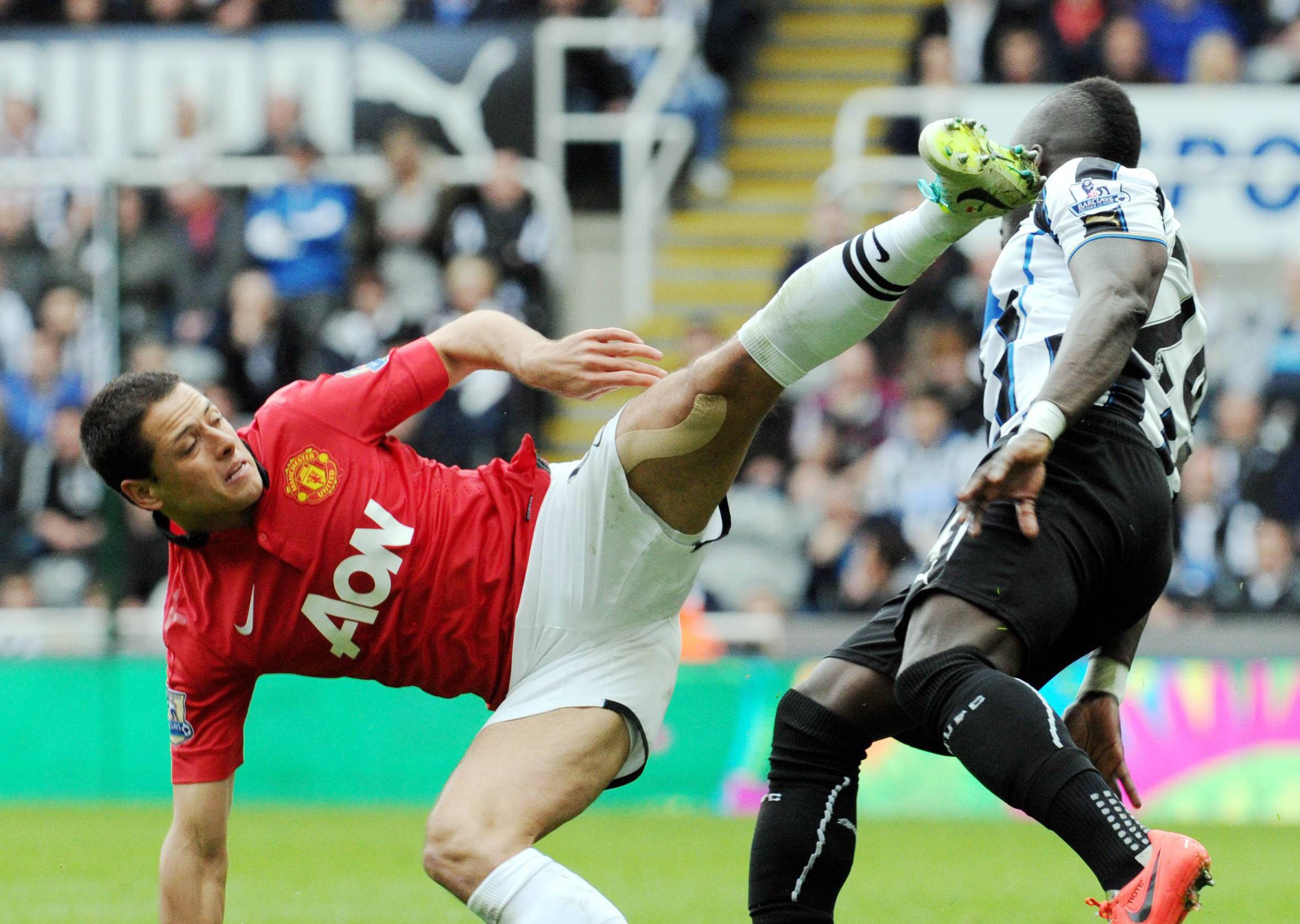 HIGH FOOT: Cheick Tiote faces a high challenge from Javier Hernandez