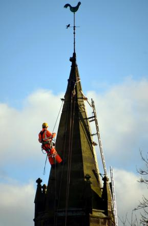 A workman on the steeple of St Mary's Church, Sherburn Village