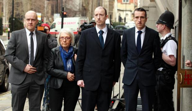 PC Blakelock's family arrive at the Old Bailey in London at the beginning of the trial - sons Lee (left) Kevin (2nd right) and Mark (right) and widow of Pc Blakelock Elizabeth Johnson