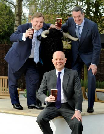 Foreign secretary William Hague with the new owners of the Black Bull Inn, Michael Ibbotson (left) and Chris Blundell (right)