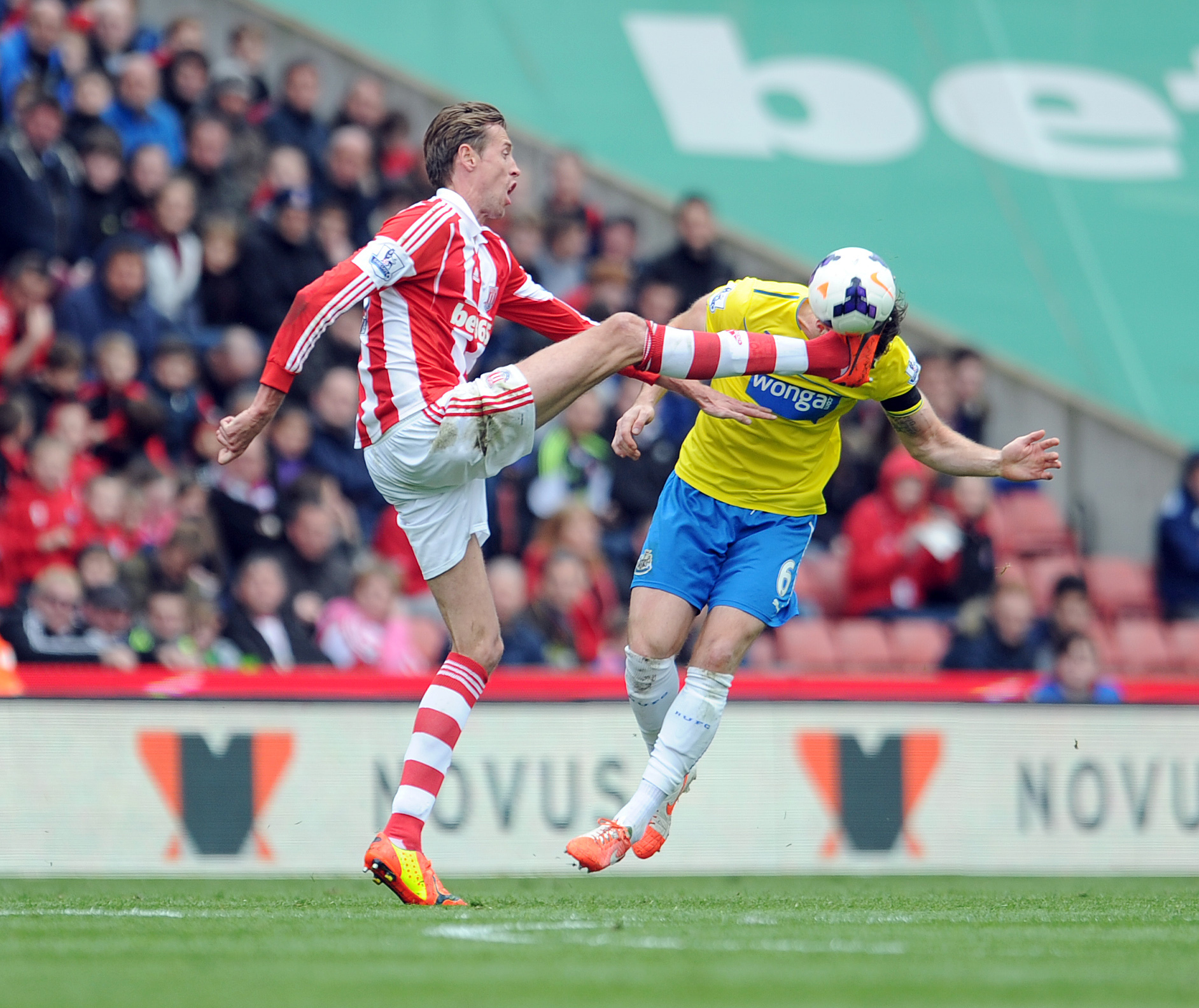 OUCH FROM CROUCH: Stoke's high-stepping striker Peter Crouch gives Newcastle's Mike Williamson a headache