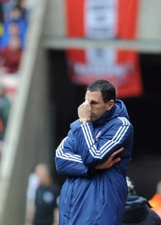 THE GAME IS UP: Sunderland manager Gus Poyet contemplating life in the Championship