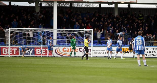 MOMENT OF DESPAIR: Hartlepool players are dejected after Chesterfield net their winning goal