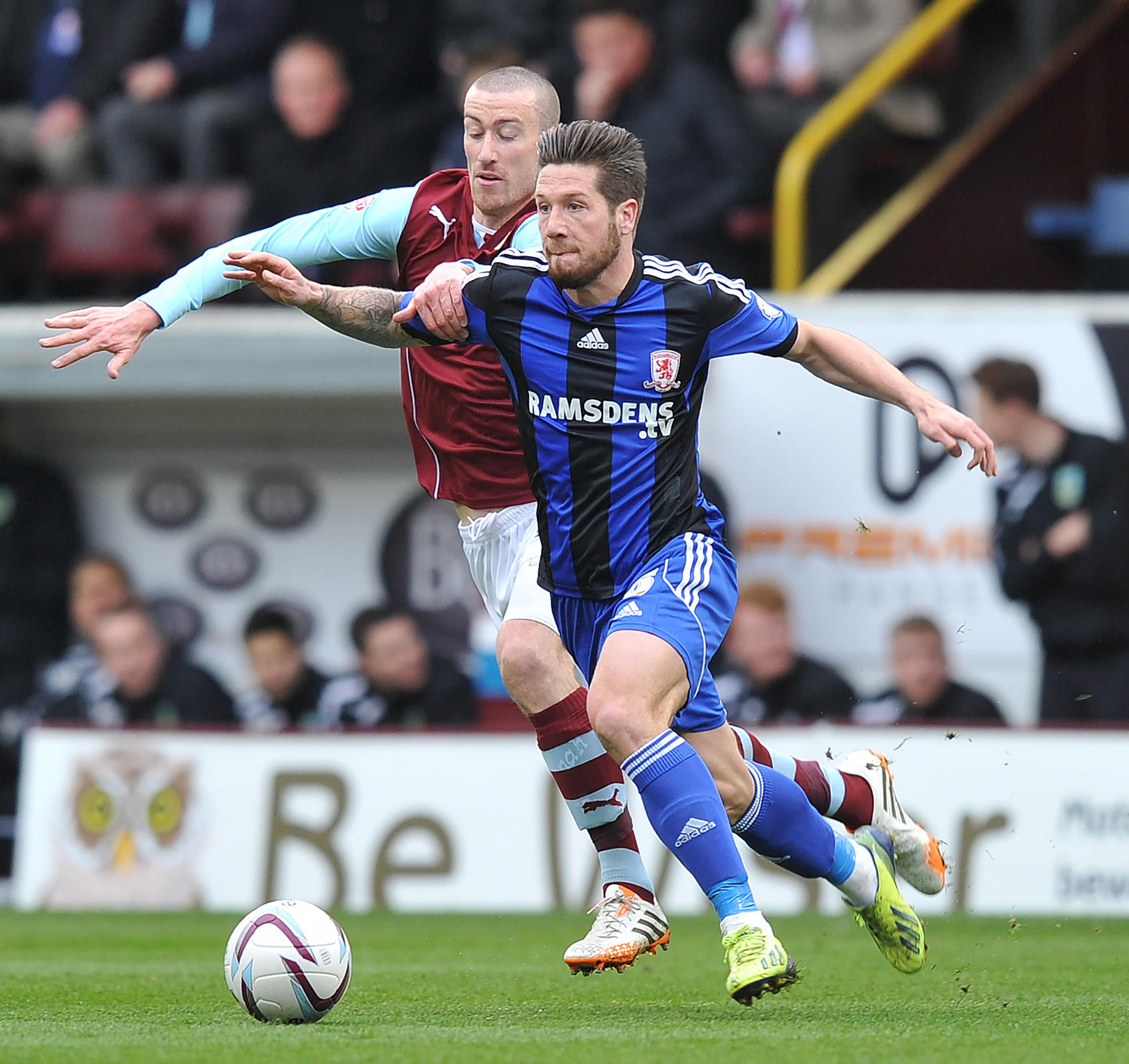 POWERING FORWARD: Middlesbrough goalscorer Jacob Butterfield is chased down by Burnley's David Jones