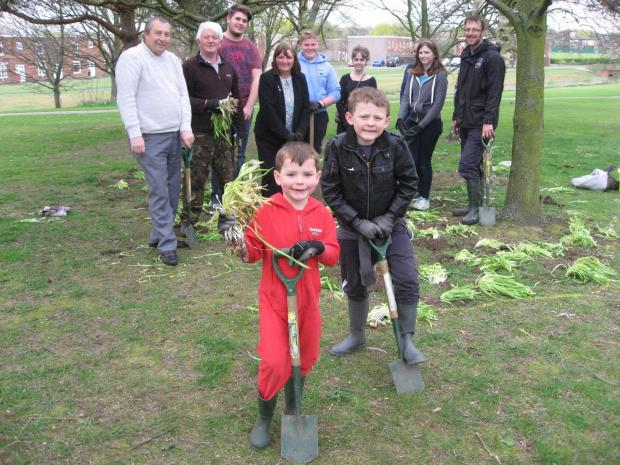 Christian Whitfield, five, and his brother Ben, seven, lead the bulb planting session at West Park in Newton Aycliffe