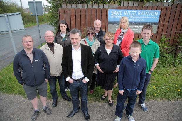 Michael Johnson (in white shirt, centre) with villagers who are opposed to building at West Rainton.