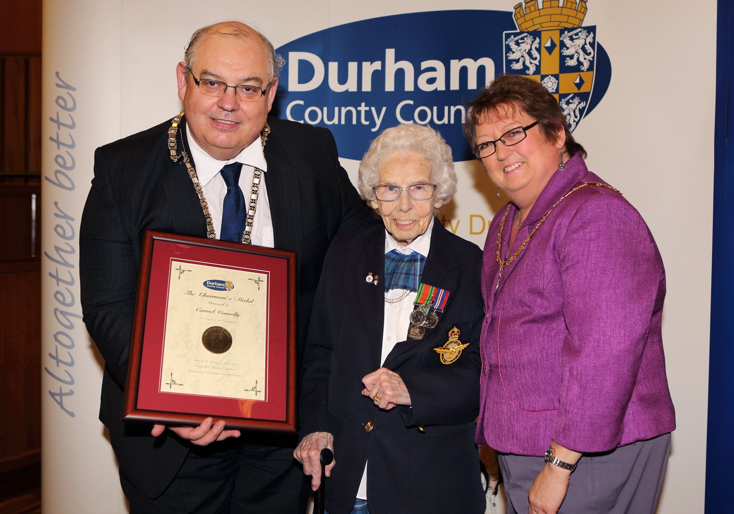 CHARITY STALWART: Carmel Connolly accepts the chairman's medal from Coun John Robinson and consort Maxine Robinson