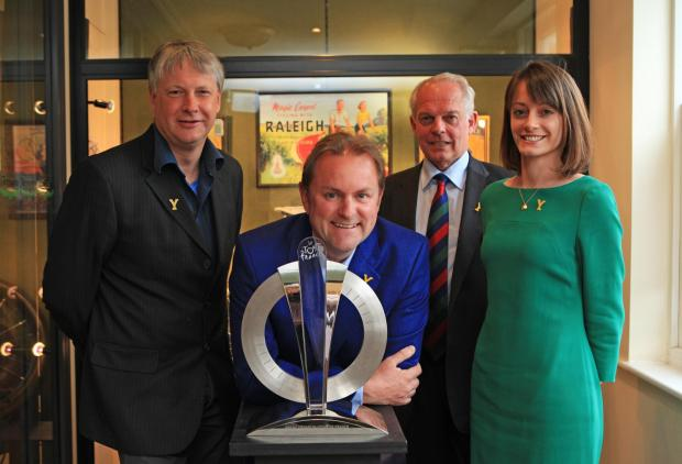 The Northern Echo: Le Tour de France trophy on display at Tennants in Leyburn, pictured from left are Richard Sanderson, chairman of the TDF Committee, Gary Verity, chief executive at Welcome to Yorkshire, Rodney Tennant, chairman of Tennant's and Jane Tennant, director