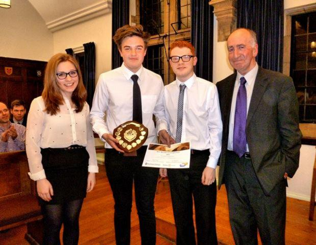 Sarah Kingston, Christian Thompson-Hails and Joshua Morgan from Framwellgate School Durham receive the Youth Speak shield from Phil Mars, of Durham Rotary Club