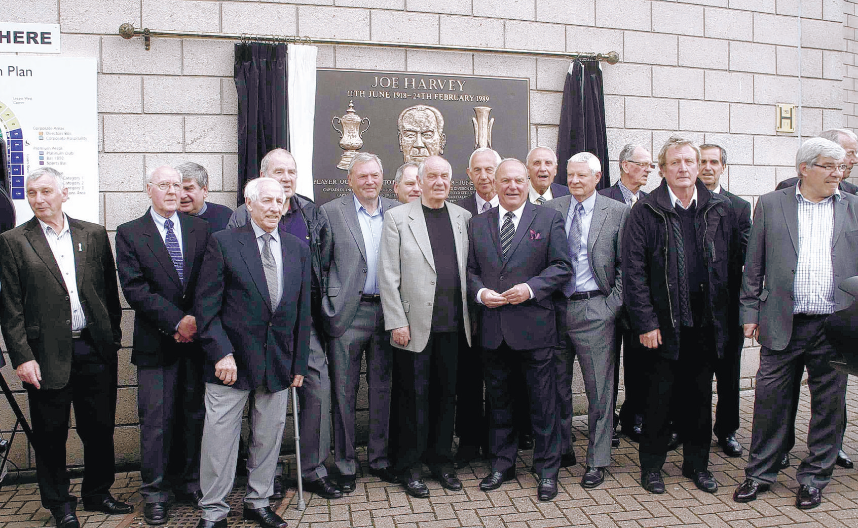 TOON TRIBUTE: Former Newcastle United players, including Frank Clark, Wyn Davies, Bobby Moncur, Vic Keeble and Malcolm Macdonald, at St James' Park yesterday as a plaque celebrating Joe Harvey's achievements as a Magpies player and manager was unveile