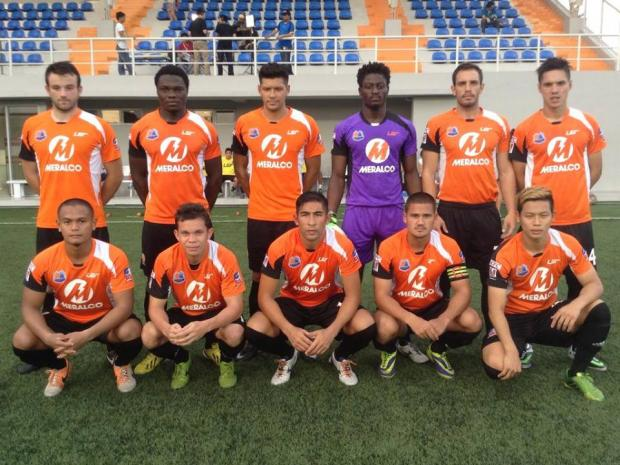 EASTERN PROMISE: Former Northallerton Town player Graham Caygill (top row, third from left) lines up with the Manila-based Loyola Meralco Sparks team ahead of his debut match.