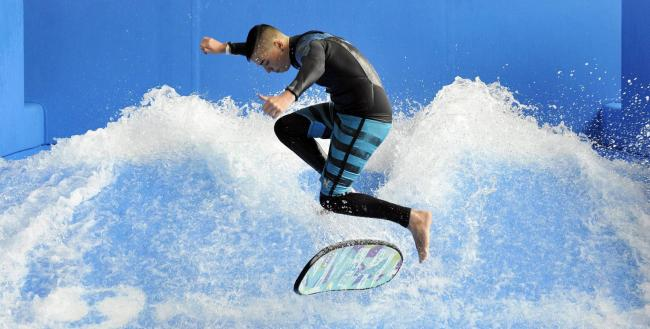 The £31m leisure and civic centre boasts one of the region's best equipped fitness suites as well as ultra-modern business facilities. This picture shows British champion Flowrider Sam Atkins trying out the waves.