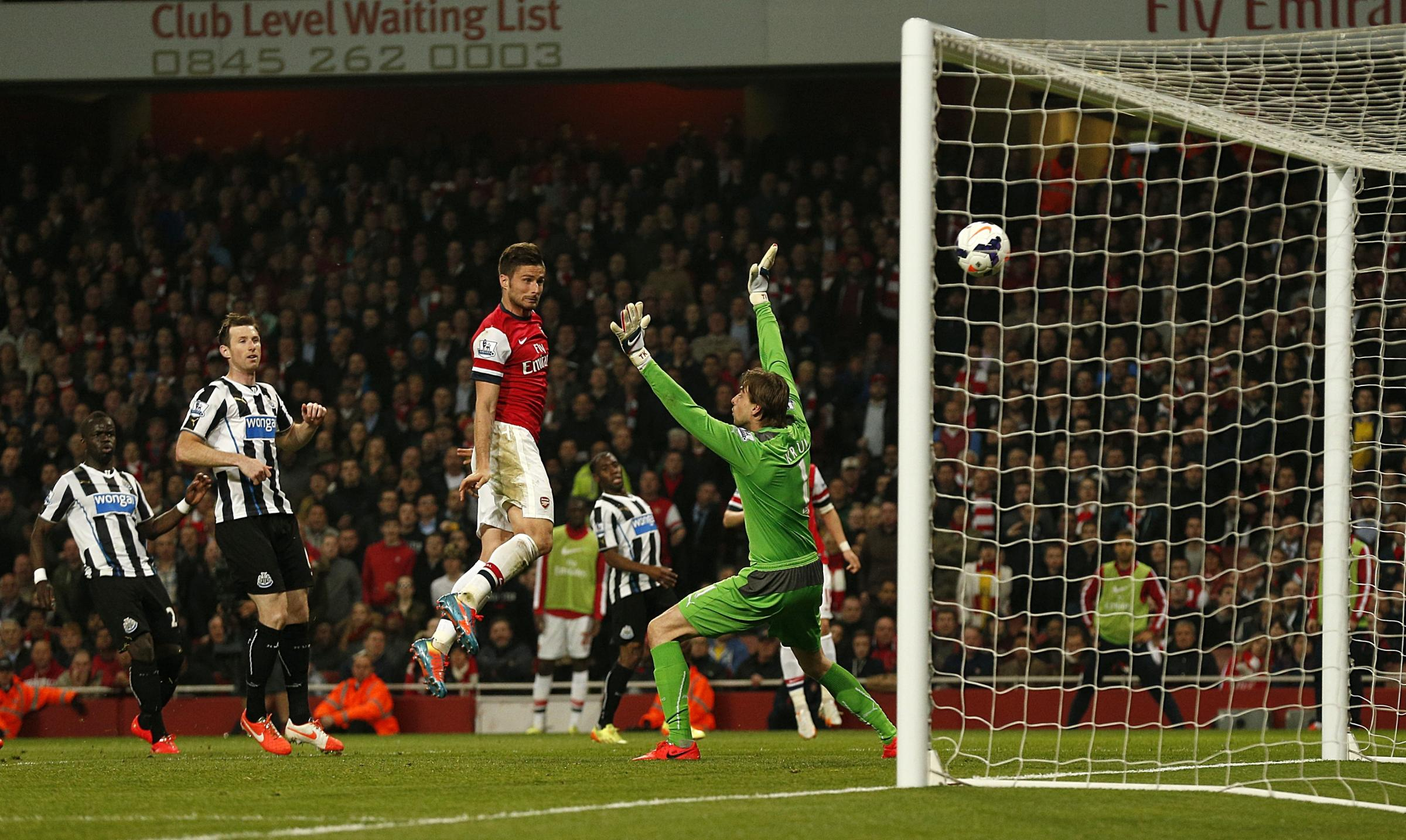 FREEDOM: Arsenal's Olivier Giroud scores his side's third goal of the game, heading in from close range as defender Mike Williamson stands off