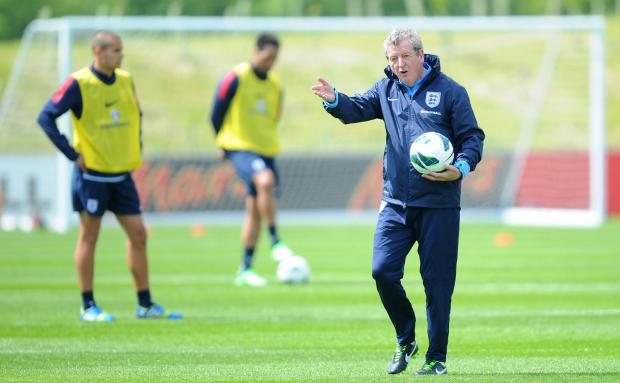 England coach Roy Hodgson gives players instructions during training at St George's Park