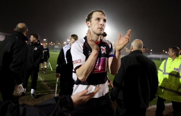 ON THE ROCKS: Darlington captain Gary Brown leaves the field after last night's 2-0 defeat to Ramsbottom United