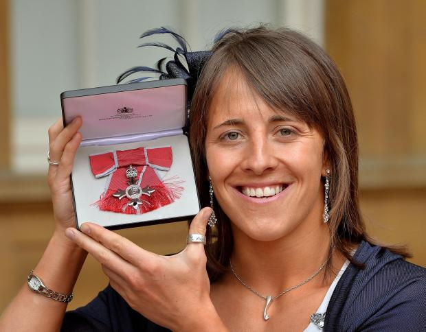 PROUD MOMENT: Katy McLean, of Darlington Mowden Sharks, with her MBE outside Buckingham Palace