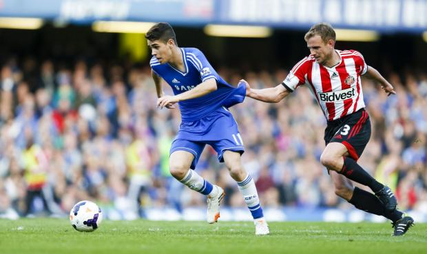 DON'T GO DOWN: Lee Cattermole, pictured fouling Chelsea's Oscar last month, says his Sunderland team-mates are aware of the consequences should Sunderland suffer relegation from the Premier League