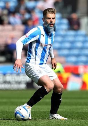 TRANSFER SAGA: Adam Clayton's future remains unclear after Brighton joined the race for the Huddersfield Town midfielder
