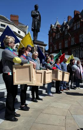 ART ATTACK: A parade to Promote the art lending library which is to be installed in Darlington, made up of wooden crates filled with a variety of artwork. Picture: CHRIS BOOTH